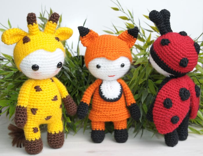 Amigurumi doll in fox costume