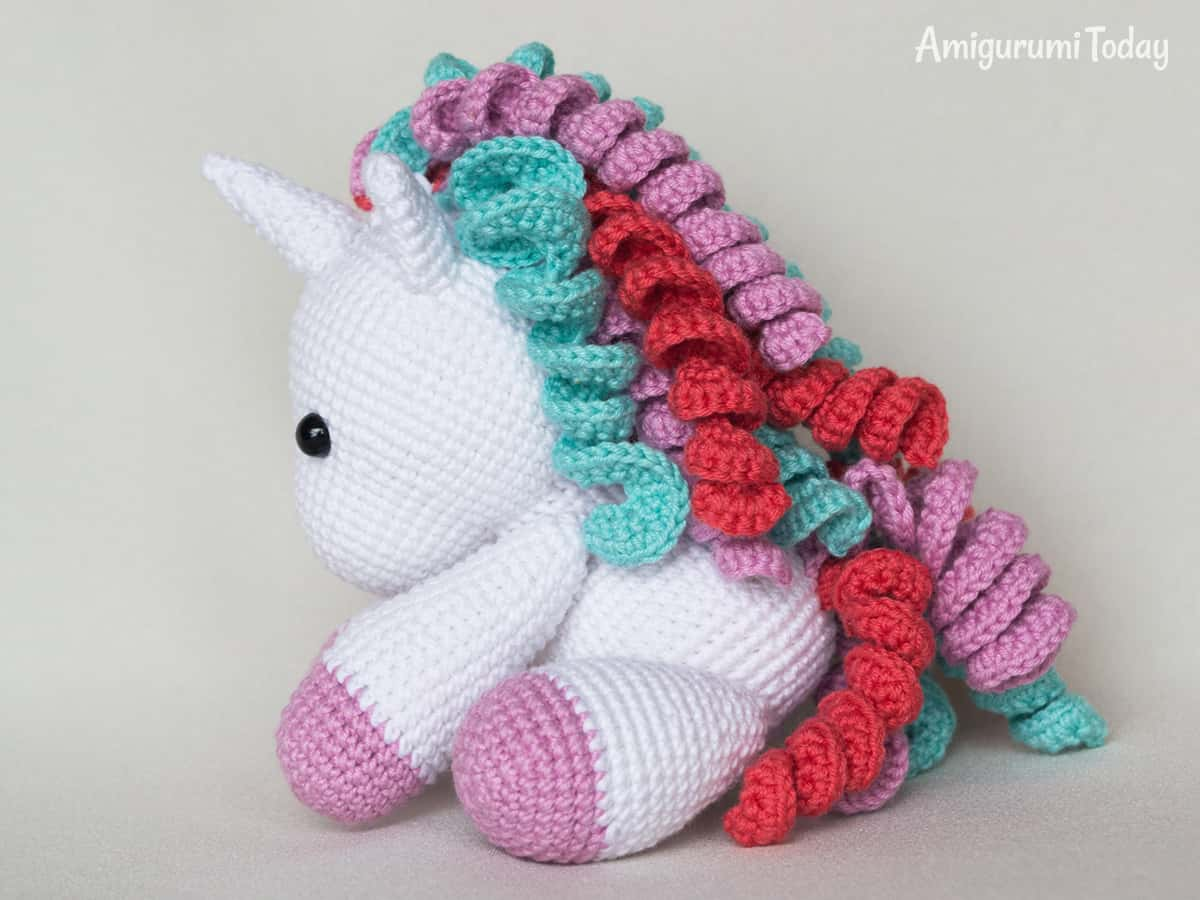 Free babe unicorn amigurumi pattern designed past times Amigurumi Today Baby unicorn amigurumi pattern