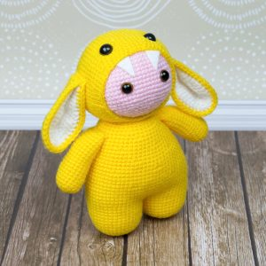 Amigurumi doll in monster suit - Crochet pattern by Amigurumi Today