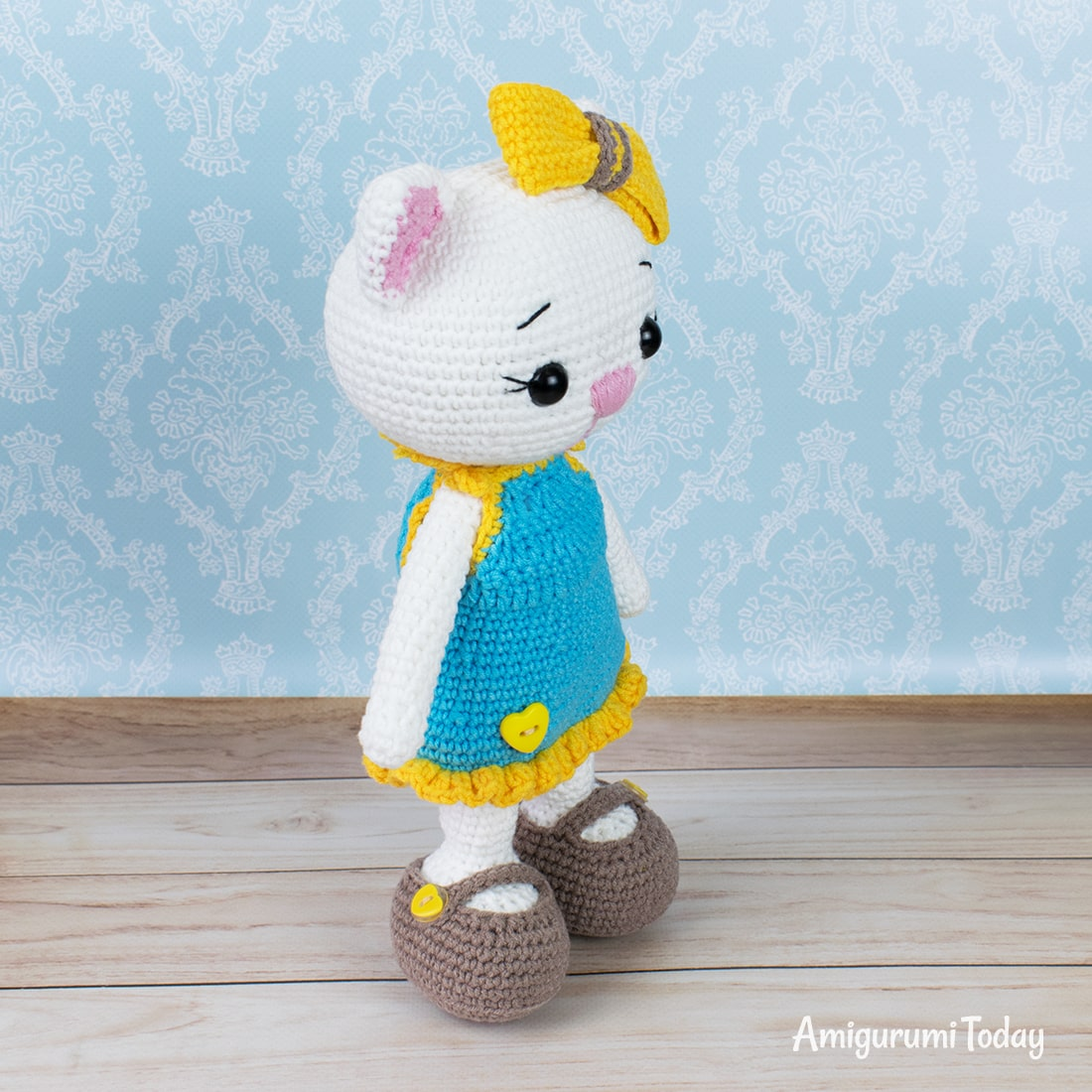 Cat doll in sundress crochet pattern by Amigurumi Today