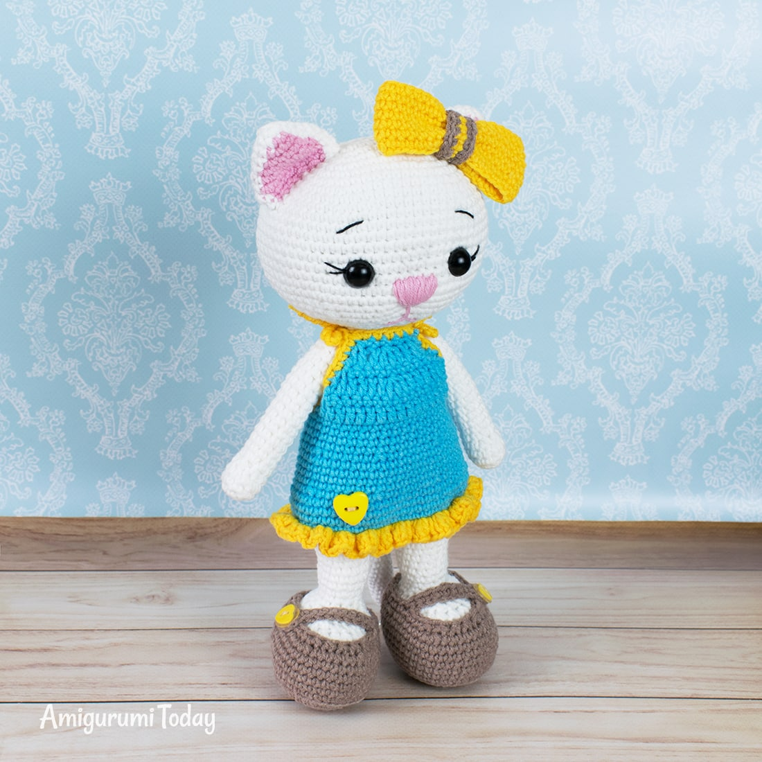 Free cat doll in sundress crochet pattern by Amigurumi Today
